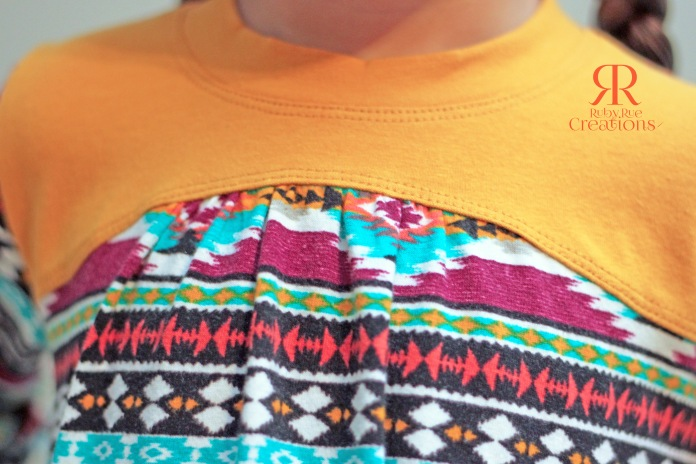 43354ac1958 Here I used Mustard Cotton Lycra from Peekaboo Fabric Shop for the yoke,  neck band and cuffs. I didn't have any trouble getting this over her head  and the ...